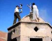 Egypt: Muslims destroying a cross atop a church.