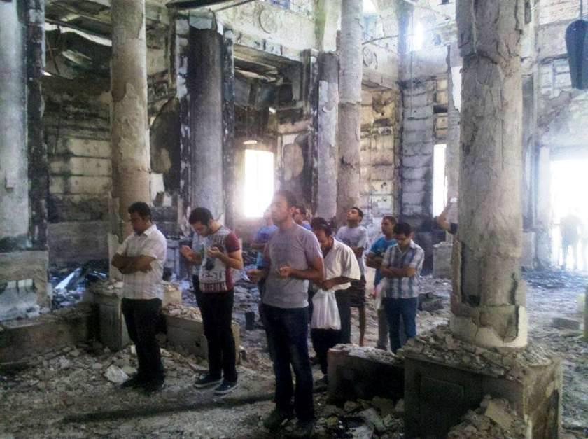 http://www.raymondibrahim.com/wp-content/uploads/2013/09/copts-pray-in-burned-church.jpg