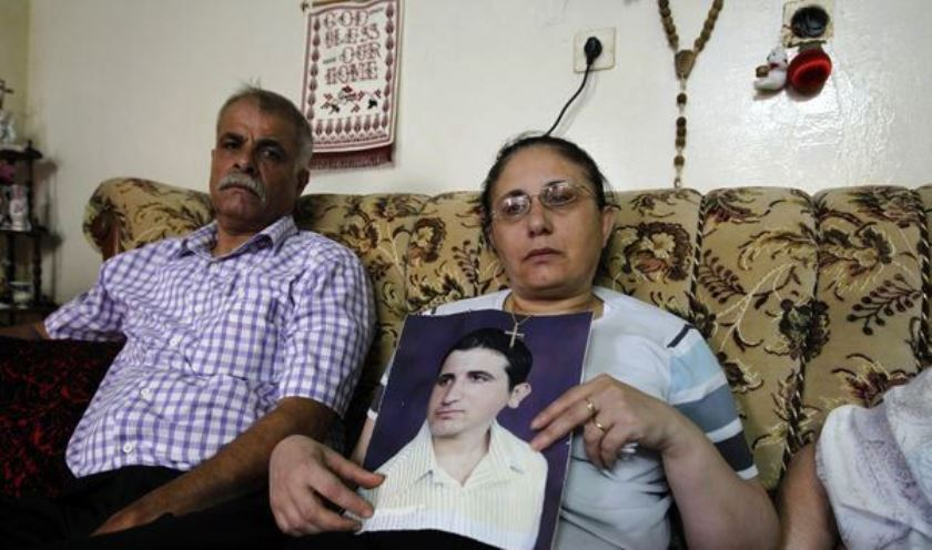 Christian family hold picture of abducted son whom officials said willingly converted to Islam.